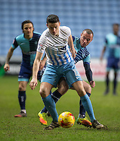 Callum Reilly of Coventry City under pressure from Michael Harriman of Wycombe Wanderers during the The Checkatrade Trophy - EFL Trophy Semi Final match between Coventry City and Wycombe Wanderers at the Ricoh Arena, Coventry, England on 7 February 2017. Photo by Andy Rowland.