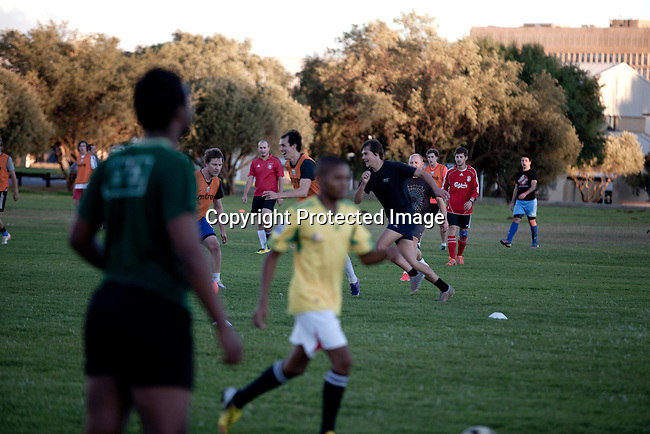BLOEMFONTEIN, SOUTH AFRICA APRIL 18, 2013: Two different football games at the University of the Free State sports grounds in Bloemfontein, South Africa. An all white and all black soccer team play on fields next to each other. Photo by: Per-Anders Pettersson