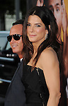 "WESTWOOD, CA - AUGUST 01: Jonathon Komack Martin and Sandra Bullock attend ""The Change-Up"" Los Angeles Premiere at Regency Village Theatre on August 1, 2011 in Westwood, California."