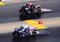 Sept. 14, 2012; Concord, NC, USA: NHRA pro stock motorcycle rider Hector Arana Jr (near) races alongside father Hector Arana Sr during qualifying for the O'Reilly Auto Parts Nationals at zMax Dragway. Mandatory Credit: Mark J. Rebilas-