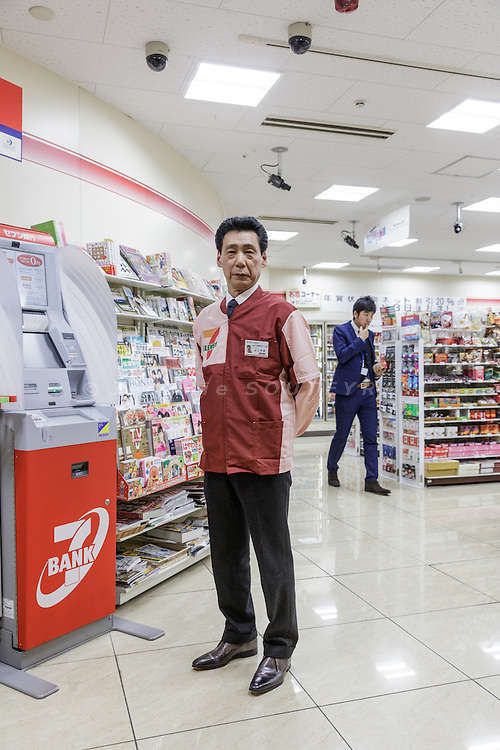 Tokyo, Japan, December 16 2016 - Portrait of Mr Shinichi YOKOYAMA, owner of three Seven-Eleven convenience stores, at the Marunouchi Tokyo Building store. <br /> Seven Bank is a bank that has all its ATMs in 7-Eleven convenience stores and is making a lot of money by charging fees for ATM users. This is a contrast to other banks that are struggling to make profits.&nbsp;One way Seven Bank saves money is by having convenience-store managers stock the ATMs with the cash from the cash register. In other words, the money you pay for your rice ball ends up back in the ATM in the same store. Banking industry experts say this is a unique business model.