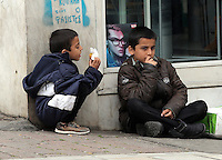 Pictured L-R: Afghan brothers Samar, 5 and Fahad, 7 eat at a street corner Tuesday 08 March 2016<br /> Re: Migrants at Victoria Square, in central Athens, Greece.