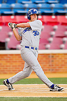 Billy Creighton #30 of the UNC-Asheville Bulldogs follows through on his swing against the Wake Forest Demon Deacons at Wake Forest Baseball Park on February 28, 2012 in Winston-Salem, North Carolina.  The Demon Deacons defeated the Bulldogs 9-8.  (Brian Westerholt/Four Seam Images)