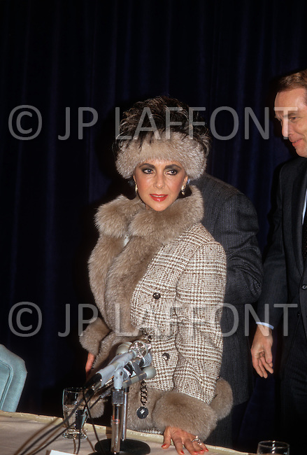 "Helmsley Palace Hotel, New York - January 14, 1987. This photograph of Elizabeth Taylor was taken at the press conference held by the Cheseborough Pond Company for the actress's new fragrance, Elizabeth Taylor's Passion. Elizabeth ""Liz"" Taylor (February 27, 1932 – March 23, 2011) was a British-American actress, who became one of the great screen actresses of Hollywood's Golden Age."