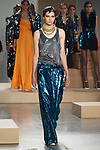 Model walks runway in a blue sequin loose fit tuxedo GIO pants from the Greta Constantine Spring Summer 2018 collection by Kirk Pickersgill and Stephen Wong on September 6, 2017; at Pier 59 Studios during New York Fashion Week.