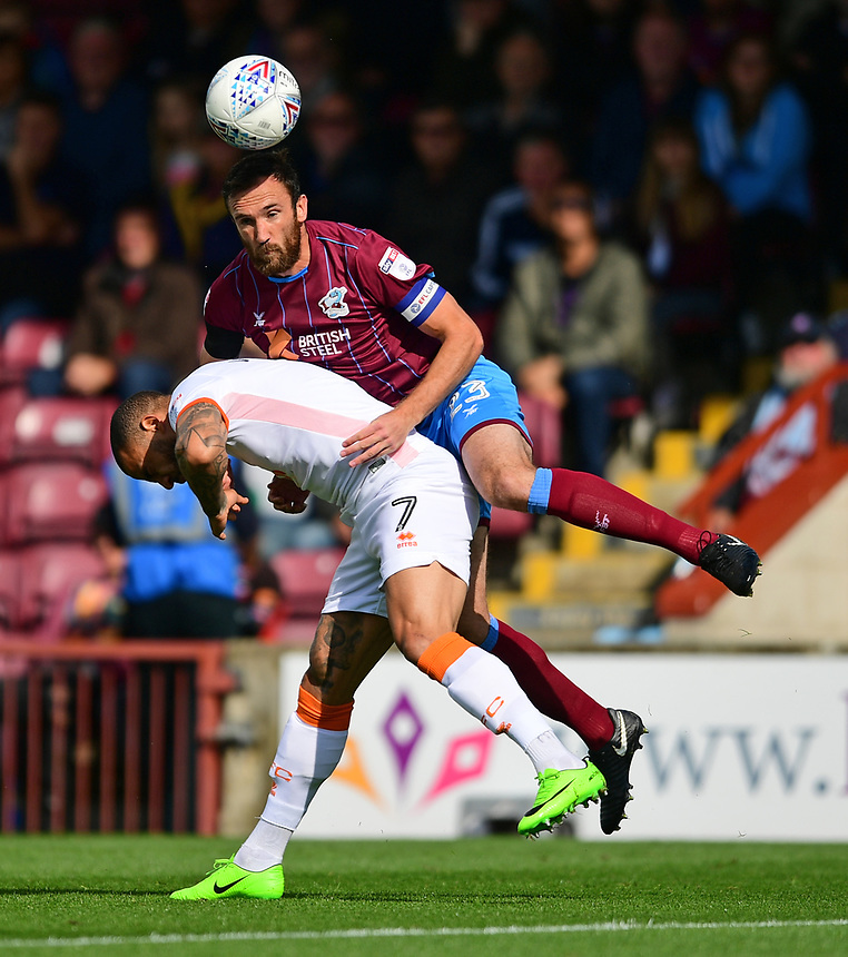 Blackpool's Kyle Vassell vies for possession with Scunthorpe United's Rory McArdle<br /> <br /> Photographer Chris Vaughan/CameraSport<br /> <br /> The EFL Sky Bet League One - Scunthorpe United v Blackpool - Saturday 9th September 2017 - Glanford Park - Scunthorpe<br /> <br /> World Copyright &copy; 2017 CameraSport. All rights reserved. 43 Linden Ave. Countesthorpe. Leicester. England. LE8 5PG - Tel: +44 (0) 116 277 4147 - admin@camerasport.com - www.camerasport.com