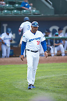 Ogden Raptors hitting coach Cordell Hipolito (37) walks towards the first base coach's box during a Pioneer League game against the Great Falls Voyagers at Lindquist Field on August 23, 2018 in Ogden, Utah. The Ogden Raptors defeated the Great Falls Voyagers by a score of 8-7. (Zachary Lucy/Four Seam Images)