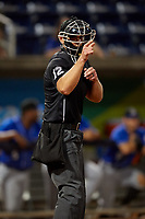 Umpire Brock Ballou calls a strike during a Southern League game between the Biloxi Shuckers and Pensacola Blue Wahoos on May 3, 2019 at Admiral Fetterman Field in Pensacola, Florida.  Pensacola defeated Biloxi 10-8.  (Mike Janes/Four Seam Images)