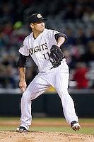 Charlotte Knights relief pitcher Javy Guerra (11) in action against the Gwinnett Braves at BB&T Ballpark on April 16, 2014 in Charlotte, North Carolina.  The Braves defeated the Knights 7-2.  (Brian Westerholt/Four Seam Images)