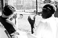 A volunteer from the First Street United Methodist Church, left, makes some music with someone at the community center the Dwelling Place in uptown New Orleans on November 24, 2005.