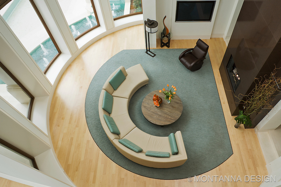 The circular shapes in the furniture echo the architecture
