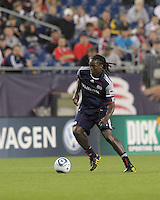 New England Revolution midfielder Shalrie Joseph (21) moves forward. The New England Revolution defeated the New York Red Bulls, 3-2, at Gillette Stadium on May 29, 2010.