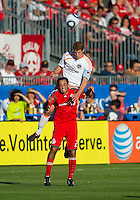 01 July 2010:  Houston Dynamo defender Andrew Hainault #31and Toronto FC midfielder Nick LaBrocca #21 in action during a game between the Houston Dynamo and the Toronto FC at BMO Field in Toronto..Final score was 1-1....