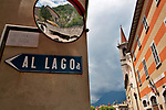 A sign pointing the way to the lake in Varenna, a town on Lake Como, Italy