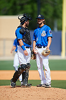 Biloxi Shuckers relief pitcher Tayler Scott (31) talks with catcher Dustin Houle (21) in a mound visit during a game against the Jackson Generals on April 23, 2017 at MGM Park in Biloxi, Mississippi.  Biloxi defeated Jackson 3-2.  (Mike Janes/Four Seam Images)