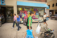 A back to school window display is seen at one of The Children's Place stores in Union Square in New York on Saturday, August 10, 2013. Retailers are reported to by readying themselves for a disappointing back-to-school season. .Back-to-school is the second biggest sales season for retailers. (© Richard B. Levine)