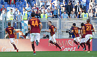 Calcio, Serie A: Roma vs Lazio. Roma, stadio Olimpico, 8 novembre 2015.<br /> Roma's Edin Dzeko, third from left, celebrates with teammates after scoring on a penalty kick during the Italian Serie A football match between Roma and Lazio at Rome's Olympic stadium, 8 November 2015.<br /> UPDATE IMAGES PRESS/Riccardo De Luca