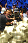 Jerry Yang is mobbed by family after winning.