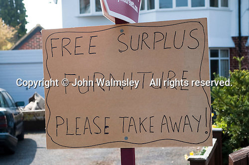 Home made sign advertising surplus household furniture which is free to be taken away, Thames Ditton, Surrey.