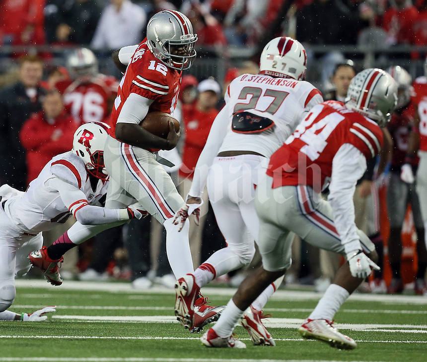 Ohio State Buckeyes quarterback Cardale Jones (12) makes a break in the line in the fourth quarter of their game at Ohio Stadium in Columbus, Ohio on October 18, 2014. (Columbus Dispatch photo by Brooke LaValley)