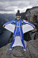 "Hans Holmefjord spreading his wings on a mountain top. Kjerag in the Lysebotn fjord is popular with BASEjumpers, but considered fairly unchallanging by the wingsuit flyers of ""Verdal'n BASE and Karsk"". © Fredrik Naumann"