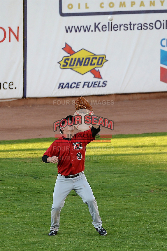 Justin Jirschele (9) of the Great Falls Voyagers gets under the fly-ball in action against the Ogden Raptors at Lindquist Field on August 13, 2013 in Ogden Utah. (Stephen Smith/Four Seam Images)