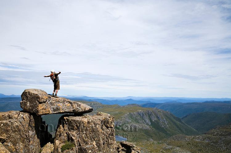 Hiker atop Cradle Mountain in Tasmania's central highlands.  Cradle Mountain-Lake St Clair National Park, Tasmania, AUSTRALIA