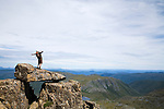 Hiker atop Cradle Mountain in Tasmania's central highlands.  Cradle Mountain-Lake St Clair National Park, Tasmania, AUSTRALIA