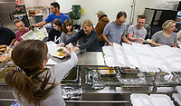 NWA Democrat-Gazette/BEN GOFF @NWABENGOFF<br /> Volunteers fill takout boxes Thursday, Nov. 28, 2019, during the annual Thanksgiving meal distribution at the First Baptist Church Olive Street campus in Rogers. <br /> <br /> Paul Olinger, a church member who helped coordinate the meal, said the event started 20 years ago 'As an outreach of the church to show the love of Christ in the community'. Volunteers from the church and the community cooked, packaged and delivered boxed meals that included ham, green beans, mashed potatoes and deserts. <br /> <br /> Open to anyone, a line wrapped around the room as families picked up boxes of food to take home, but Olinger estimates that 98 percent of the meals are delivered by volunteers.