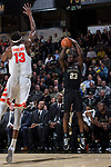 Chaundee Brown (23) of the Wake Forest Demon Deacons shoots over Paschal Chukwu (13) of the Syracuse Orange during second half action at the LJVM Coliseum on January 3, 2018 in Winston-Salem, North Carolina.  The Demon Deacons defeated the Orange 73-67.  (Brian Westerholt/Sports On Film)