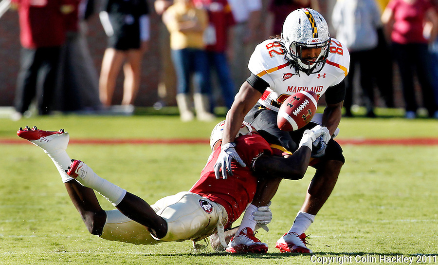 TALLAHASSEE, FL 10/22/11-FSU-MARY102211 CH-Florida State's Mike Harris breaks up a pass intended for  Maryland's Marcus Leak during first half action Saturday at Doak Campbell Stadium in Tallahassee. .COLIN HACKLEY PHOTO