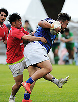 Action from the Village Kings 10s rugby tournament  match between Aiga Malisi (red) and Wellington Samoan (blue) at Jerry Collins Stadium in Porirua, New Zealand on Saturday, 21 October 2017. Photo: Dave Lintott / lintottphoto.co.nz