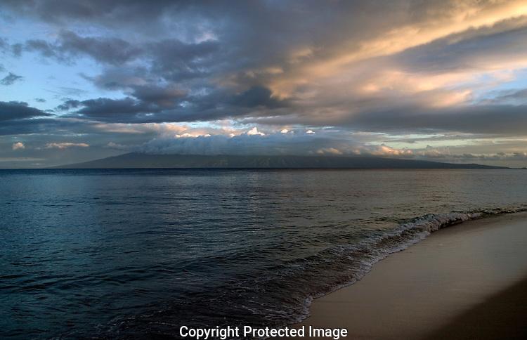 Sunrise over the Hawaiian island of Molokai as seen from the Kaanapali beach on Maui.