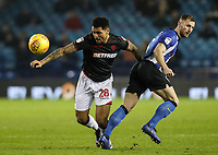 Bolton Wanderers' Josh Magennis competing with Sheffield Wednesday's Tom Lees <br /> <br /> Photographer Andrew Kearns/CameraSport<br /> <br /> The EFL Sky Bet Championship - Sheffield Wednesday v Bolton Wanderers - Tuesday 27th November 2018 - Hillsborough - Sheffield<br /> <br /> World Copyright © 2018 CameraSport. All rights reserved. 43 Linden Ave. Countesthorpe. Leicester. England. LE8 5PG - Tel: +44 (0) 116 277 4147 - admin@camerasport.com - www.camerasport.com