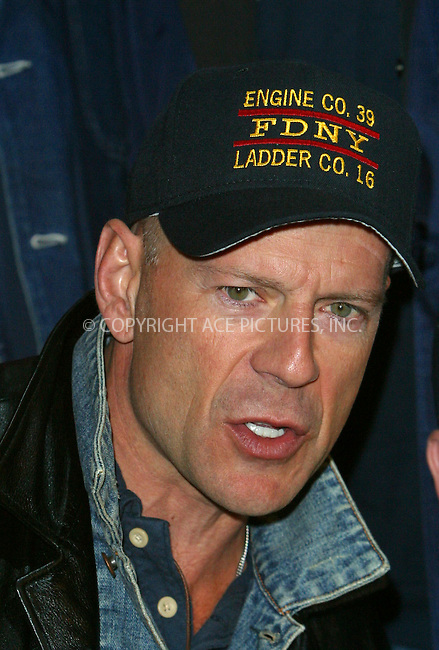 "Bruce Willis making an appearance at Planet Hollywood in Times Square to promote his latest action flick ""Tears of the Sun."" New York, February 26, 2003. Please byline: Alecsey Boldeskul/NY Photo Press.   ..*PAY-PER-USE*      ....NY Photo Press:  ..phone (646) 267-6913;   ..e-mail: info@nyphotopress.com"