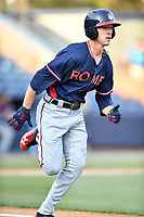 Rome Braves center fielder Drew Waters (11) runs to first base during a game against the Asheville Tourists at McCormick Field on April 17, 2018 in Asheville, North Carolina. The Braves defeated the Tourists 8-5. (Tony Farlow/Four Seam Images)