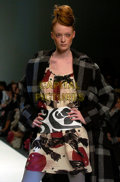 MODEL.At the Eley Kishimoto a/w 2007/8 Catwalk Show during London Fashion Week, BFC Tent, London, England, February 16th 2007..half length runway modelling brown bird eagle beige red patterned print dress tunic.CAP/CAN.©Can Nguyen/Capital Pictures