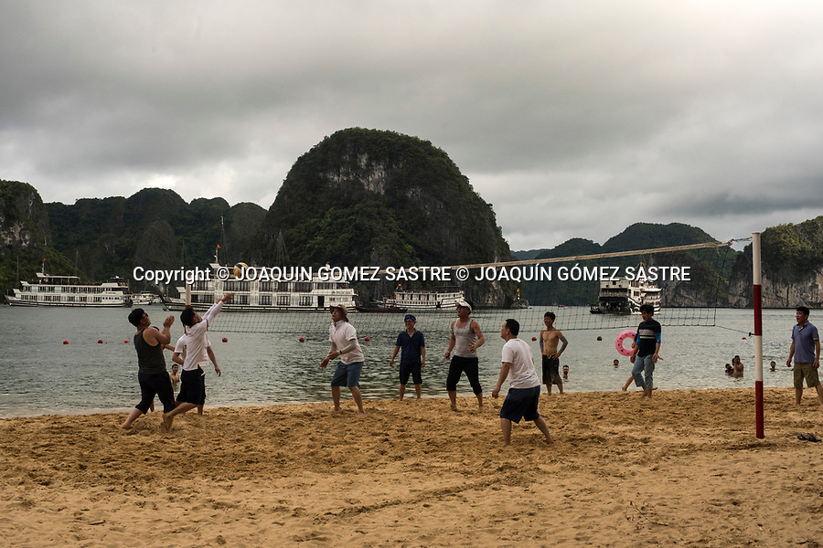 Young Vietnamese play beach volleyball on Titop Island in HaLong Bay (Vietnam)<br /> HALONG-VIETNAM