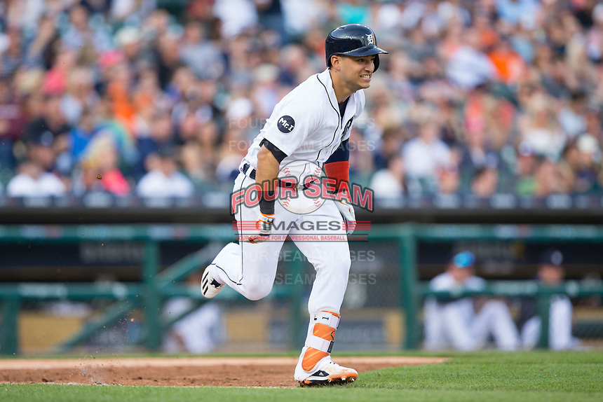 Jose Iglesias (1) of the Detroit Tigers hustles down the first base line against the Chicago White Sox at Comerica Park on June 2, 2017 in Detroit, Michigan.  The Tigers defeated the White Sox 15-5.  (Brian Westerholt/Four Seam Images)