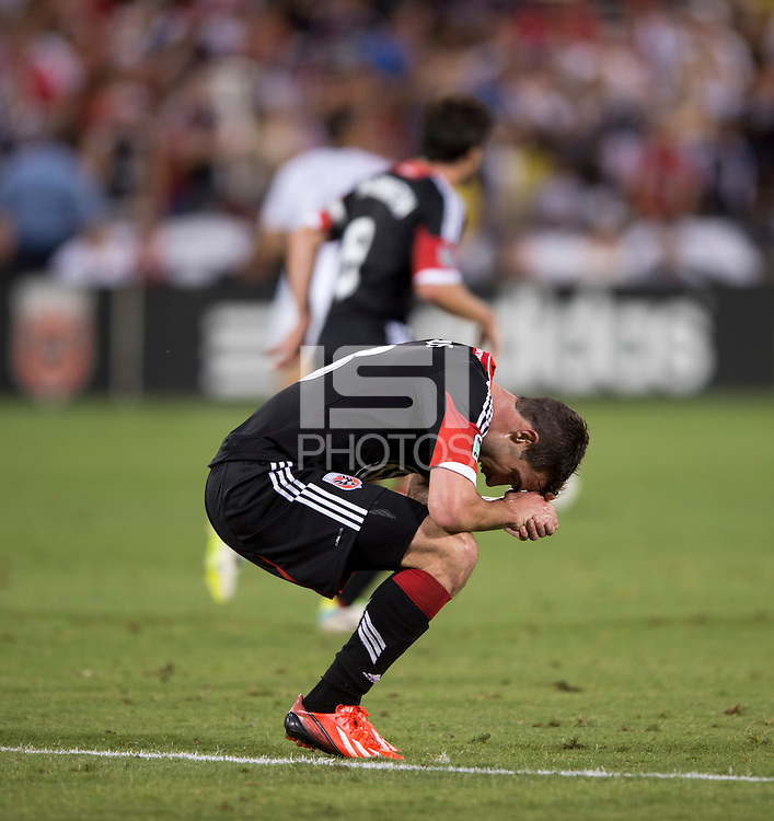 Chris Pontius (13) of D.C. United reacts to a missed chance during a Major League Soccer match at RFK Stadium in Washington, DC. D.C. United lost to the Vancouver Whitecaps, 1-0.