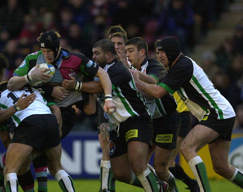 Photo. Peter Spurrier.Parker Pen Challenge Cup 17/01/2004 Harlequins v Montauban.Jim Evans  find his attack held up by the defending Montauban forwards. Mohamed Ben Bouhout [right of Evans] centre Fabrice Solden, and Cedric Bergaz..