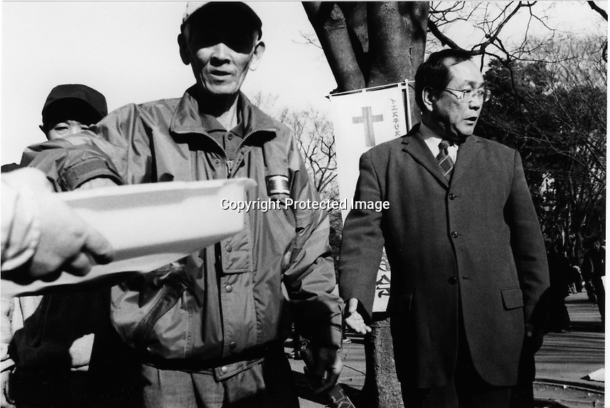 Former Yakuza, Japanese gangstars became Christian missionaries having a service to homeless people at Ueno Park, Tokyo Japan