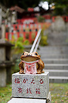 Fuku Kaeru, Fortune Frog shrine at the exit of Fushimi Inari Taisha head shrine. Kaeru means both a Frog and Come back or Return in Japanese. Kyoto, Japan 2017.