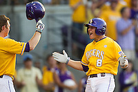 LSU Tigers outfielder Mason Katz #8 celebrates hitting a first inning home run during the NCAA Super Regional baseball game against Stony Brook on June 10, 2012 at Alex Box Stadium in Baton Rouge, Louisiana. Stony Brook defeated LSU 7-2 to advance to the College World Series. (Andrew Woolley/Four Seam Images)