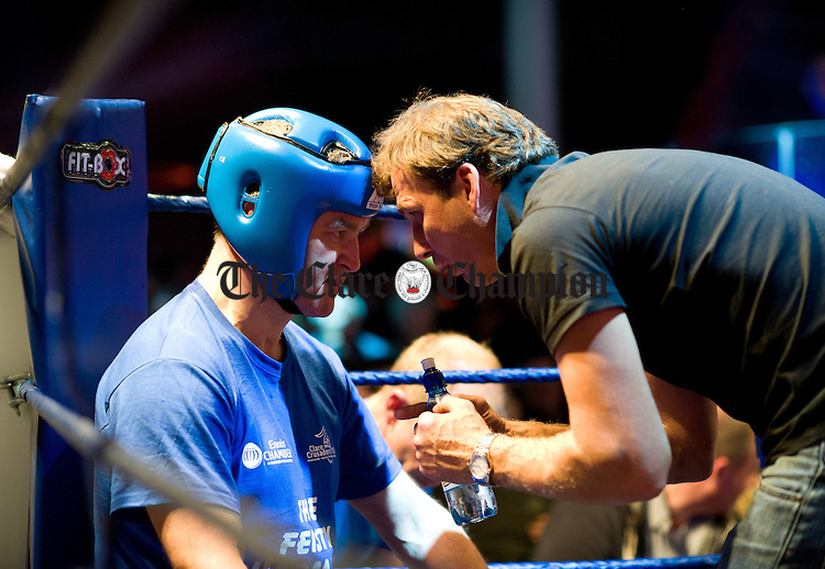 Brian Mc Elhinney gets some advice in his corner during the Clare Conquest boxing event at the Queens, Ennis. Photograph by John Kelly.