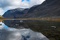 Mountain reflection in small lake along Dag Hammarskjöldsleden, Lappland, Sweden