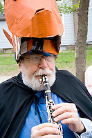 Musician playing clarinet and in costume. MayDay Parade and Festival. Minneapolis Minnesota USA