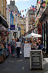 People shopping and sitting outside the Couer de Lion pub inNorthumberland passage, Bath, Somerset, England