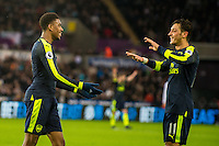 ( L-R )  Alex Iwobi of Arsenal and Mesut Ozil of Arsenal  Celebrates the third goal during the English Premier League game between Arsenal and Swansea at the Liberty Stadium in Swansea ,Wales, UK. Saturday 14 January 2017