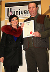 Short Stories runner upper Miceal Rooney accepts his certificate from Mona Daly..Picture: Shane Maguire / www.newsfile.ie.